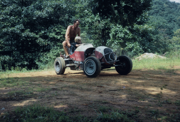 Nine-year-old Vaun in a midget racer in Georgia with grandfather.